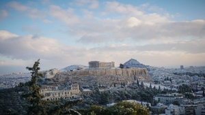 A general view of the Acropolis Hill (L) and Lykavvitos Hill (R) covered with snow. A snow storm over Athens is keeping the mercury far below zero