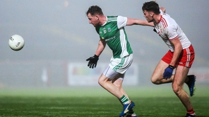 Fermanagh's Aidan Breen and Tyrone's Brian Kennedy