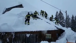 Volunteer firefighters in the ski resort of Hohentauern work to clear snow