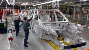 The Society of Motor Manufacturers and Traders said that investment in Britain's automotive sector fell by almost 50% last year
