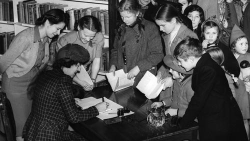 Enid Blyton signing autographs in a London bookshop. Photo: Hulton-Deutsch Collection/ CORBIS/Corbis via Getty Images