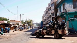 Malian riot police arrive in a vehicle as they deploy during a protest called by opposition parties in Bamako