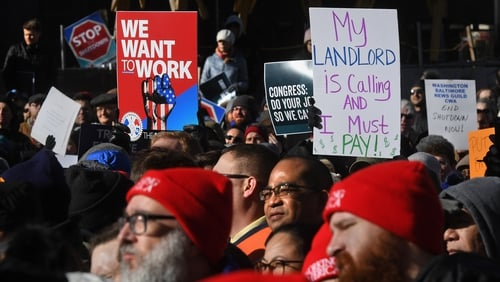 US federal workers have held protests calling for the partial shutdown to end