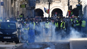 Tear gas is thrown at protesters in Paris