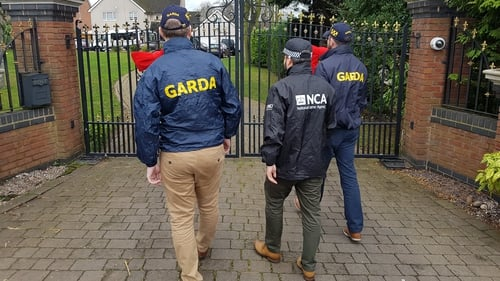 Gardaí were part of a search team that raided the gang leader's house today (Pic: National Crime Agency)