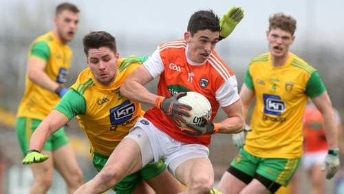 Armagh's Rory Grugan pursued by Brendan McCole and Conor Morrison