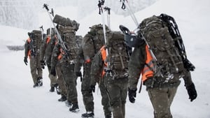Austrian soldiers walk at the valley station of the Hochkar cable car in Austria