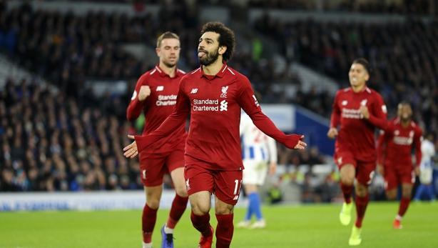 Salah celebrates after scoring a penalty against Brighton