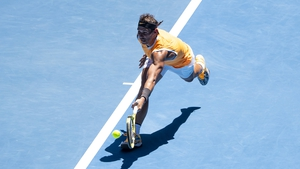 Rafa Nadal hits a backhand in his first round match against James Duckworth