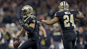 Marshon Lattimore is congratulated by his teammate Vonn Bell after a second quarter interception
