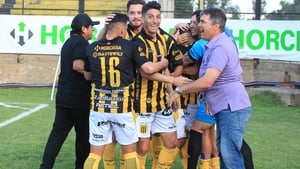 Almirante Brown players celebrate a goal