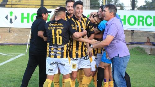 Almirante Brown players celebrate a goal