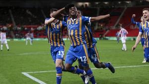 Fejiri Okenabirhie helped Shrewsbury Town to a famous win