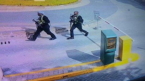 CCTV footage showed four attackers, in black and heavily armed, entering the compound
