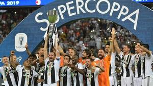 Juventus' Italian defender Giorgio Chiellini lifts the trophy