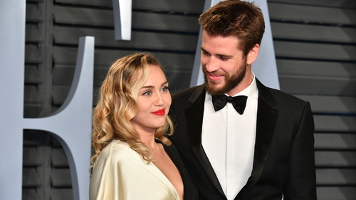 "Liam Hemsworth: ""I feel so lucky to be with someone like her. It's great. Very lucky.''"
