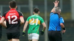 Referee James Molloy awards Leitrim a free as he signals that Mayo performed four hand-passes