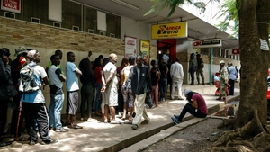 Long queues have formed at petrol stations and shops