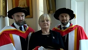 The Cranberries' Noel (L) and Mike (R) Hogan with Dolores O'Riordan's mother Eileen O'Riordan at the University of Limerick on Friday