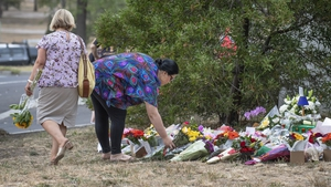 People leave floral tributes at the site where Aiia Maasarwe's body was found