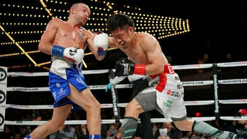 TJ Doheny, in blue shorts, dodges a punch from Japan's Ryohei Takahashi at Madison Square Garden