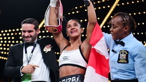 Amanda Serrano has her hand hoisted as she secured the super flyweight world title