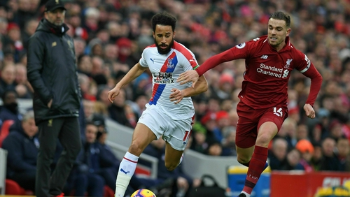 Andros Townsend in action against Jordan Henderson