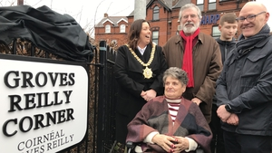 Belfast Lord Mayor Deirdre Hargey, Gerry Adams and MP Paul Maskey with Clara Reilly (front) at the corner of the Falls Road in west Belfast