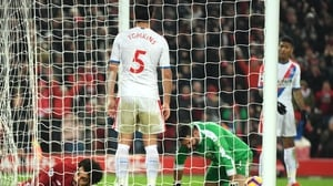 Crystal Palace goalkeeper Julian Speroni reacts after Liverpool score their third goal at Anfield