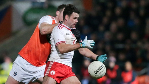 Tyrone's Darren McCurry holds off Brendan Donaghy of Armagh at the Athletic Grounds