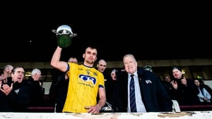 Enda Smith lifting the trophy after Roscommon's victory.