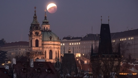 The so-called 'super blood wolf moon' is seen over the Church of Saint Nicholas in Prague, Czech Republic