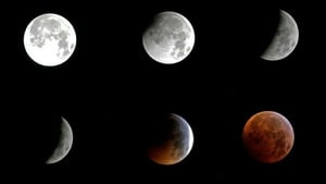 This combination of pictures shows the moon during different stages of the lunar eclipse in Sintra, Portugal, early today