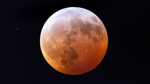 Moon turns red during the lunar eclipse in Washington