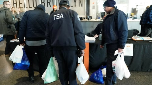 An employee of the Transportation Security Administration at the food bank in NYC