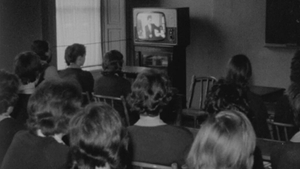 Secondary school students watching 'Telefis Scoile' in classroom (1964)