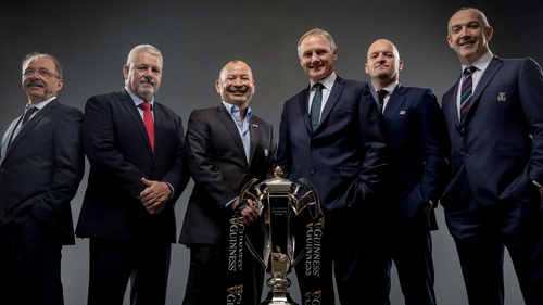 Keep your enemies close: Joe Schmidt poses with his rival coaches