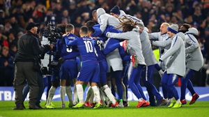 Chelsea players react after the shootout victory over Spurs