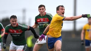 Roscommon's Enda Smith with Diarmuid O'Connor and Fionn McDonagh of Mayo
