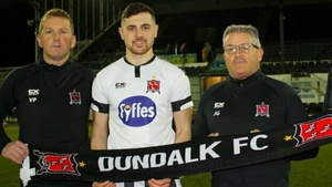 Vinny Perth (L) and John Gill (R) pose with new signing Jordan Flores. Photo: Dundalk FC
