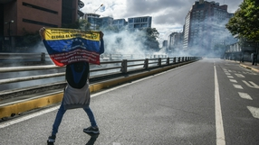 A demonstrator holding the Venezuelan flag during an opposition rally in the capital Caracas