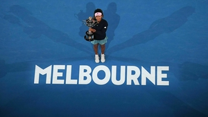 Centre stage: Japan's Naomi Osaka celebrates with the trophy