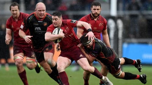 Munster's Ronan O'Mahony tries to hold off Nic Cudd of Dragons