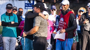 Jordan Spieth and Patrick Reed embrace at the first tee