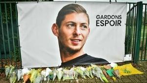Flowers alaid under a portrait of Argentinian forward Emiliano Sala at FC Nantes training centre La Joneliere