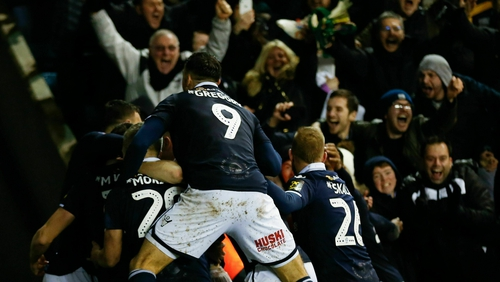 Millwall players and fans celebrate their late winner against Everton
