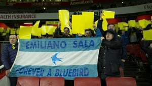 Fans display a tribute flag to Emiliano Sala