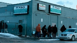 People gather at Neighborhood Service Organization in Detroit - warming centres have been opened in many cities