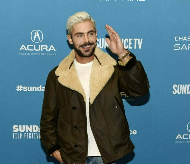 """Zac Efron, who portrays serial killer Ted Bundy in """"Extremely Wicked, Shockingly Evil and Vile,"""" waves to photographers at the premiere of the film during the 2019 Sundance Film Festival, Saturday, Jan. 26, 2019, in Park City, Utah. (Photo by Chris Pizzello/Invision/AP)"""