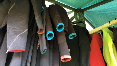 The core materialof wetsuits is neoprene foam, a synthetic rubber made from petroleum.